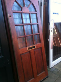Exterior hardwood door with frosted glass