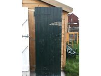 Heavy, solid wood outhouse/shed door