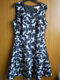 Yumi Repeat Zebra Print Sleeveless Dress- Black