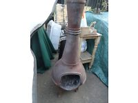 vintage CAST IRON CHIMINEA pot belly 3 legged 3ft 6in high.
