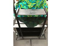 Black TV stand has a matching glass TV table available