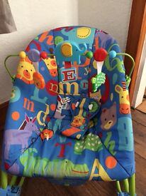 Infant bouncer/rocker with calming vibrations