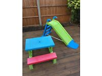 Children's slide and picnic table