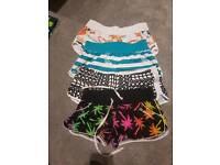 Mix of girls board shorts size small/10