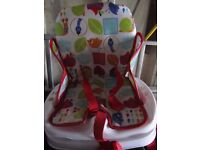 Child seat for fastening to full size dining chair.