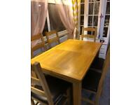 Oak extendible dining table with six chairs