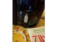 Juicer with Jason vale diet book