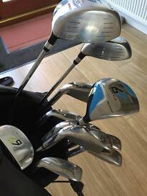 Golf clubs as new Dunlop full set with bag & stand golf covers . & rain cover.