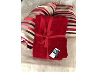 Red and cream striped cushions with matching chenille throw
