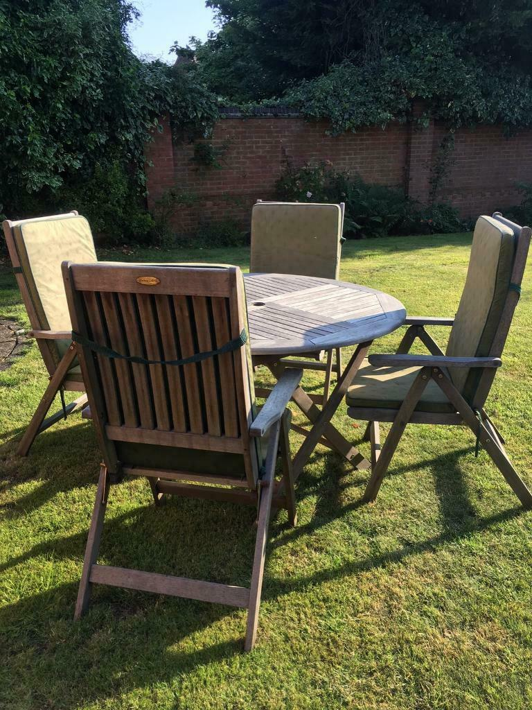 Winchester round wooden garden table & 4 chairs | in ...