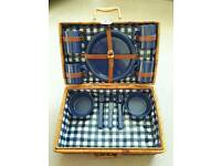 Wicker picnic basket c/w plates, bowls, mugs and cutlery