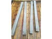four 5 ft concrete posts never used in very good condition
