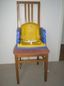 Childs booster seat with tray