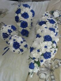 Wedding bouquets. Ivory and royal blue