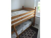 Pine High rise bunk bed and pine trundle bed with mattresses