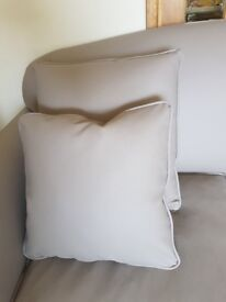 Unused taupe coloured faux leather cushions