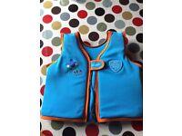 Blue child's life jacket