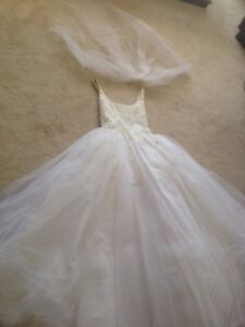 Women's white bridal gown with veil set