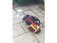 Junior golf bag with 5 clubs (3 wood, 7 & 8 iron, pitching wedge and putter) suit 3 - 5 yrs approx.