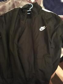 Nike tracksuit as good as new size XL