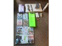 Wii console, wii fit board, 2 controllers, 10 games and accessories