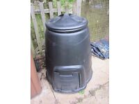 Two identical black composter bins