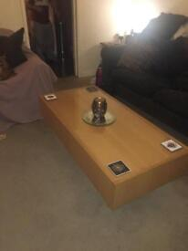 Large Coffee table with glass top and two large storage drawers.
