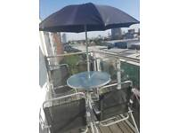 Modern glass finish garden table, 4 chairs and umbrella for outdoor usr