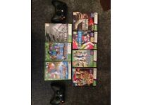 X Box 360 with sensor 2 controllers and 7 games including Minecraft and Call of Duty Black Ops II.