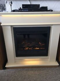Lovely fire surround with electric heater and remote control.