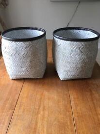 Two woven chalk finish storage baskets