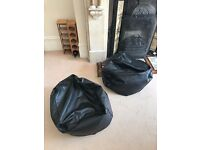 Pair of black pouffes