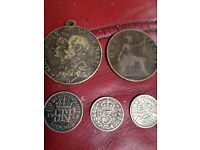 3 silver coins a medal and a 1897 penny