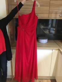 Red maxi prom dress, cross over strap at the back. Beads down the side.