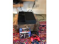 Ps4 with 2 controllers and 7 games