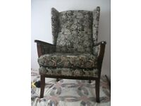 Fabric covered wing back armchair