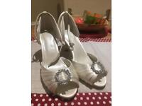 Ivory satin wedding shoes with diamanté detail