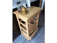 Kitchen trolley/island with two drawers, bottle rack, shelves and on wheels