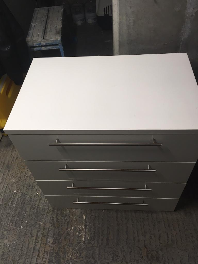 White Chest of drawers. Shiny!