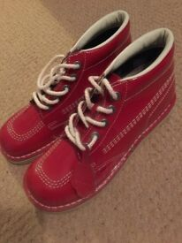 Red patent kickers.