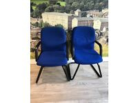 Twelve blue fabric covered office chairs