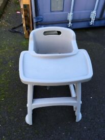 Child's plastic high chair