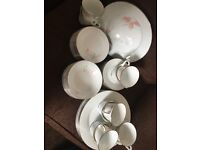 Tea cups, saucers, plates, side plates and bowls