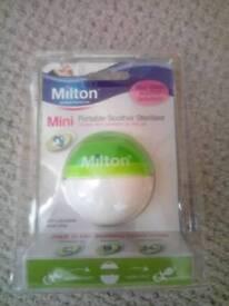 Mini dummy portable soother steriliser.