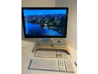 Apple Mac mini with Apple monitor keyboard and mouse