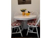 White Pedestal Dining Table and Four Matching Chairs