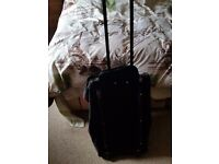 Black suitcase bag with wheels