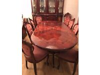 Highly Polished Italian Dining Table with 12 matching chairs