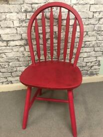 Pine wheel back chair, painted in red and dark waxed to a high sheen.