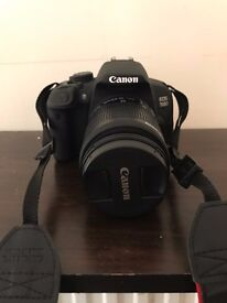 Canon EOS 700d with bag, spare battery, user manuals and lens in photos.